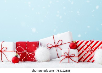 Christmas, shopping background with gift boxes in a white and red color.