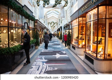 Christmas shopping centre in London. People stroll in the Burlington Arcade in London on November 21, 2013. It is one of the best-known London shopping arcades at Christmas in the heart of Mayfair