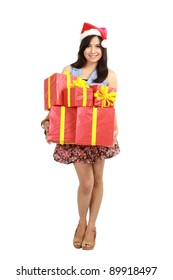 Christmas shopping woman holding gifts wearing red Santa hat isolated on white background.