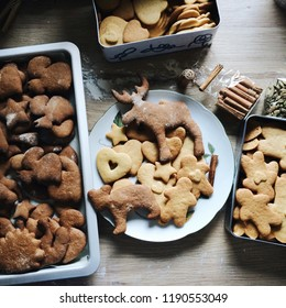 Christmas shortbread cookies and gingerbread cookies, different shapes: animals, stars, hearts, snowmen