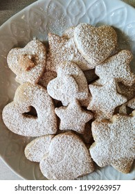 Christmas shortbread cookies with powdered sugar. Close up, top view