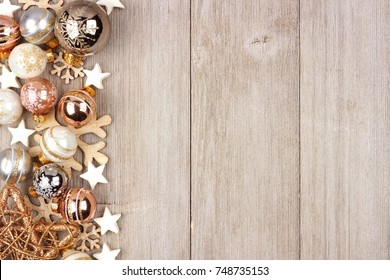 Christmas side border with white and gold ornaments on a rustic wood background