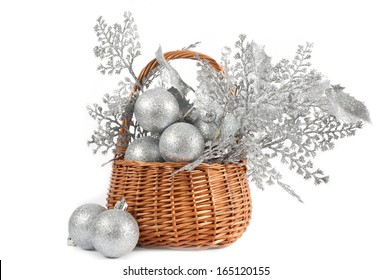 Christmas silver decorations in a wicker basket