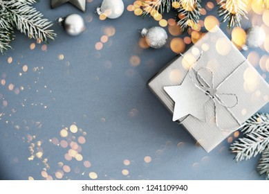 Christmas silver gifts, presents, ornaments on blue holiday background top view. Merry Christmas greeting card, frame. Winter xmas holiday theme. Happy New Year. Noel. Flat lay