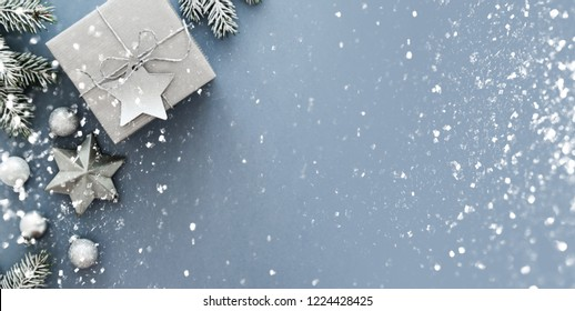 Christmas silver handmade gift boxes on blue background top view. Merry Christmas greeting card, frame. Winter xmas holiday theme. Happy New Year. Flat lay