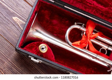 Christmas silver trumpet in box. Brass trumpet in velvet case. Traditional musical instrument.