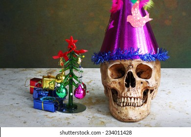 Christmas skull wearing fancy cap on marble with Christmas tree