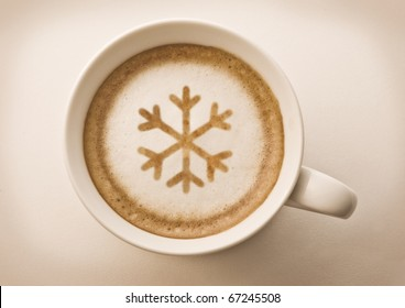christmas snow flake , drawing on latte art coffee cup