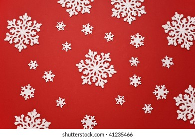 christmas snowflake pattern on red background