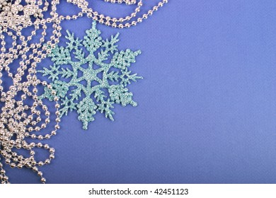 Christmas snowflake with pearls on blue