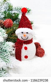 christmas snowman in fir branches on a white background, vertical closeup
