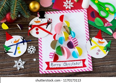 Christmas snowman merry gift and Christmas tree card. Handmade. Project of children's creativity, handicrafts, crafts for kids.