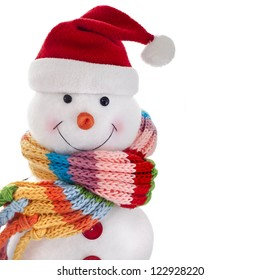 Christmas snowman with wool scarf and santa claus hat , isolated on white background