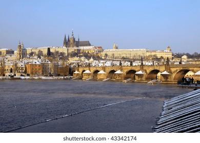 Christmas Snowy Prague gothic Castle on the River Vltava with Charles Bridge