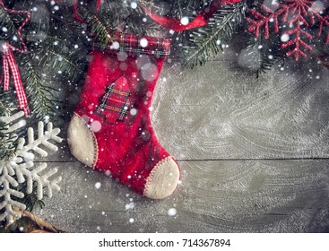 Christmas sock on the wooden background with blank space for ads