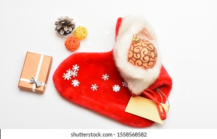Christmas sock white background top view. Small items stocking stuffers or fillers little christmas gifts. Fill sock with gifts or presents. Contents of christmas stocking. Christmas celebration.