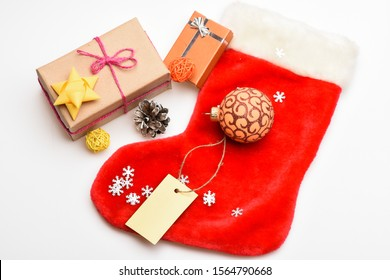Christmas sock white background top view. Fill sock with gifts or presents. Contents of christmas stocking. Christmas celebration. Small items stocking stuffers or fillers little christmas gifts.