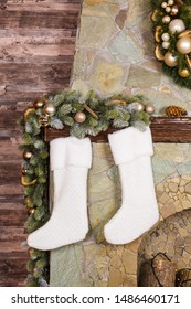 Christmas socks on fireplace.  Traditional stylish  New Year accessories