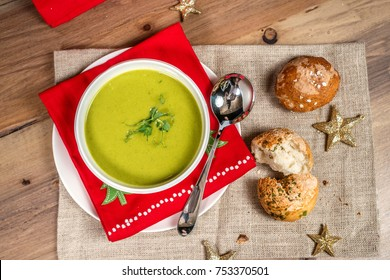 Christmas soup. Traditional green lentil soup with festive holiday decor and holiday background