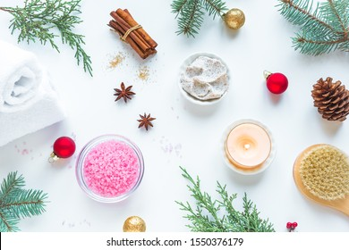 Christmas Spa Set, flat lay with towels, fir branches and candle on white background, top view. Winter festive relax and spa concept.