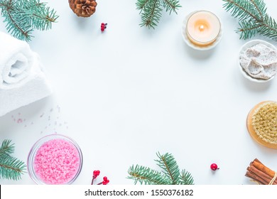 Christmas Spa Set, flat lay with towels, fir branches and candle on white background, copy space. Winter festive relax and spa concept.
