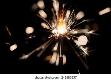 Christmas sparkler on black background