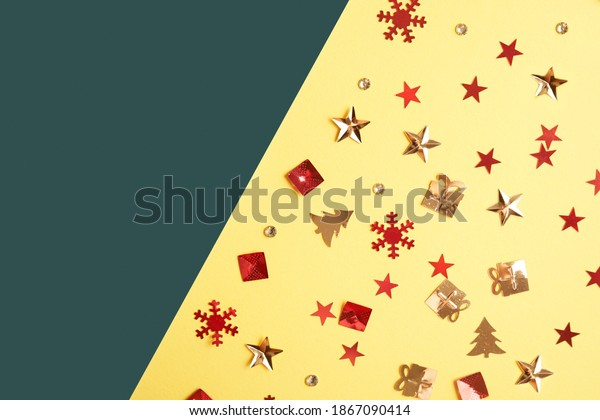 Christmas sparkles in the form of a Christmas tree, gifts, stars on a yellow background with a copy space. High quality photo