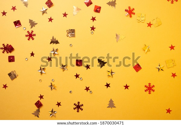 Christmas sparkles in the form of a Christmas tree, gifts, stars on a yellow background. High quality photo