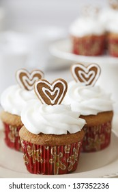 Christmas Spice cupcakes decorated with gingerbread hearts.