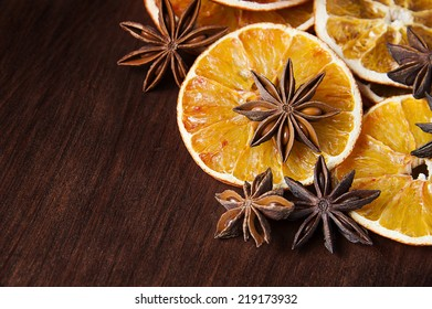 Christmas spices. Anise stars and sliced of dried orange