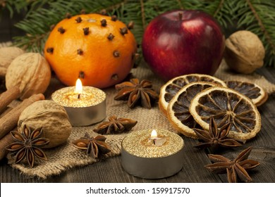 Christmas spices with decoration on wooden board