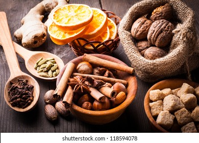 Christmas spices - nuts, brown sugar, dried orange, kandamon, cloves, cinnamon, nutmeg, ginger and anise