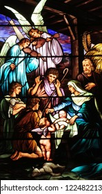 Christmas stained glass window depicting birth of Jesus Christ