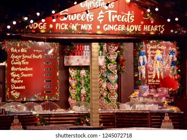 Christmas stall in Bristol waterfront shopping complex as part of the annual festive celebrations. Traditional Diner bread souvenirs. Bristol, England November 2018
