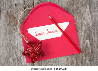 Christmas star and envelope with child's letter to Santa