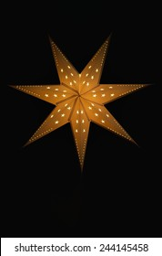 Christmas star isolated on black