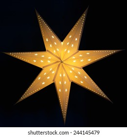 Christmas star isolated on black
