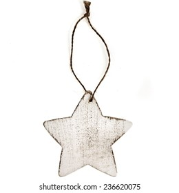 Christmas star made of wood with rope isolated on white