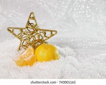christmas star and tangerines in the snow