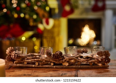 Christmas still life with candle and fireplace - cosy winter image.