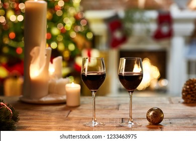 Christmas still life with with glasses of red wine - cosy winter time.