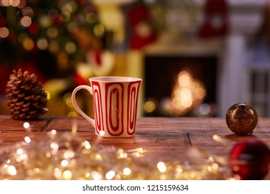 Christmas still life with mug and fireplace - cosy winter time.