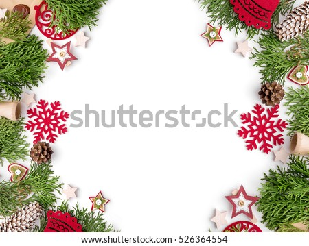 Christmas still life. Red toys, spruce branches and decorative Christmas ornaments on a white background.