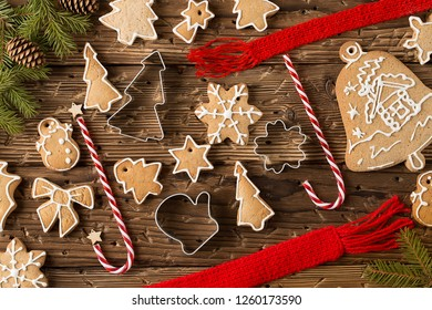Christmas still life with traditional gingerbread cookies on wood. New Year and Christmas celebration. Winter holidays concept. Christmas decorations. Top View.