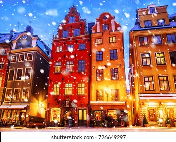 Christmas in Stockholm. Old colorful houses on the square Stortorget in Gamla Stan.Inscriptions in the Swedish language: a list of meals served by food establishments