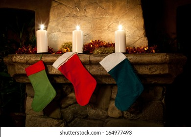 Christmas stocking on fireplace background. Chimney place, candles. Vintage interior