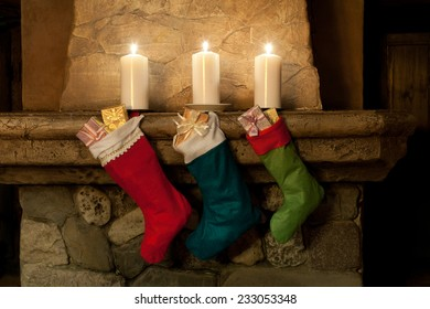 Christmas stocking on fireplace background. Chimney, candles. Christmas socks, decoration, gifts.