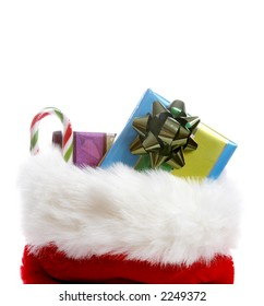 A christmas stocking overflowing with gifts