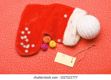 Christmas stocking sock shaped bag. Keep family traditions. Stocking stuffers idea. Santa stocking with christmas decorations. Christmas sock red background top view. Traditional christmas attribute.