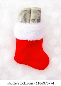 Christmas Stocking Stuffed with Hundred Dollar Bills